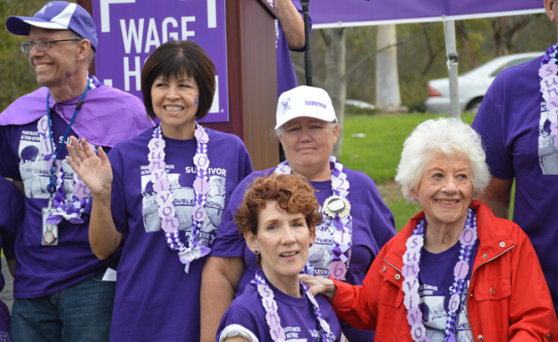 Influencer of Hope Charlotte Rae stands with fellow survivors at walk to end pancreatic cancer