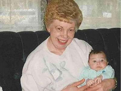Jane Johnson, Teri Larson's mother, holding her grandchild