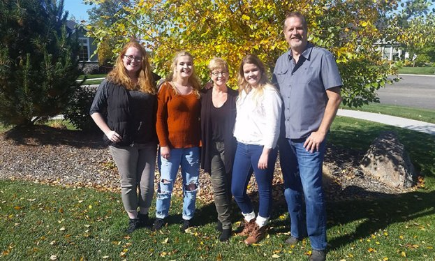 Pancreatic cancer survivor with her husband and three adult daughters on a fall day in Idaho