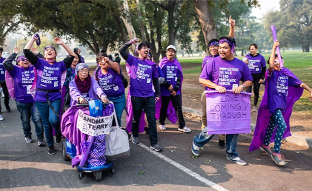 Participants pose for funny photo at the 5K walk to end pancreatic cancer