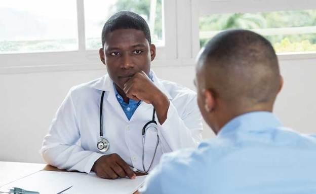 An African-American doctor and patient discuss pancreatic cancer statistics