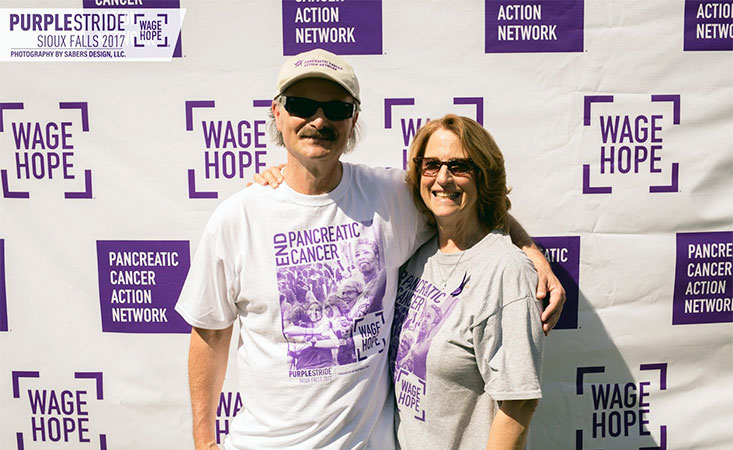 13-year survivor and wife advocate for pancreatic cancer research at PurpleStride Sioux Falls.