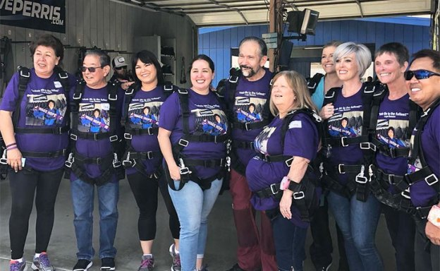 Pancreatic cancer survivors, family members and friends gather for annual skydive.