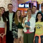 Pancreatic cancer patient and husband stand with their children and family.