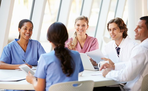A multidisciplinary team meets to discuss their pancreatic cancer patient's progress