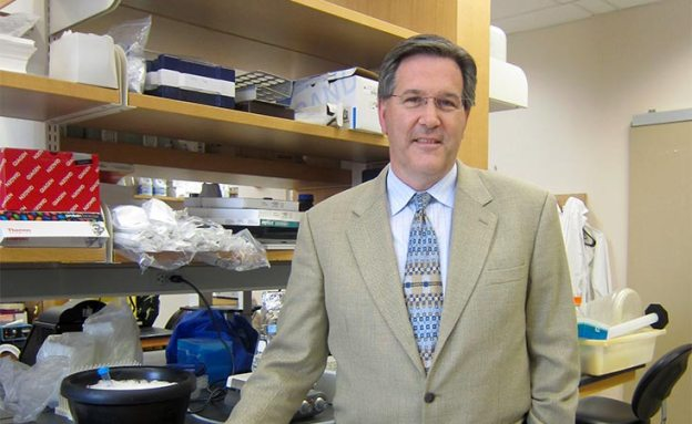 Pancreatic cancer researcher in lab focused on personalizing treatment for patients
