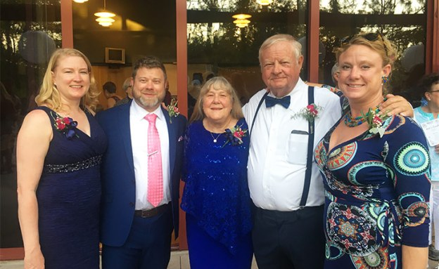 Stage IV pancreatic cancer survivor and successful clinical trial participant at son's wedding