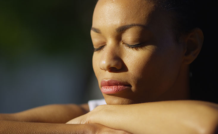 Pancreatic cancer caregiver takes a moment for self-care to meditate outside