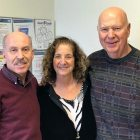 Two pancreatic cancer survivors and a caregiver in healthcare specialist's office