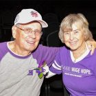 Stage IV pancreatic cancer survivor and his wife wearing purple PanCAN t-shirts