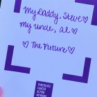 A sign tells why this PanCAN advocate is involved