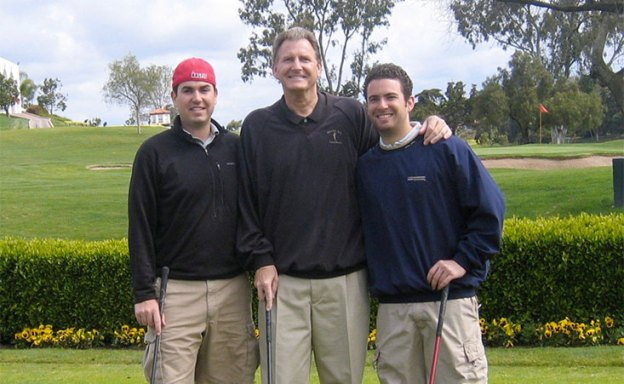 Dad and two adult sons golfing