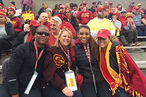 Husband and Wife with two adult daughters at a football game.