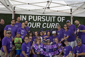 Team posing for photo at PurpleStride Miami 2019