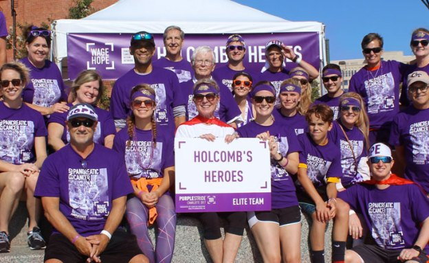 Stage 4 pancreatic cancer survivor with friends and family at PanCAN PurpleStride event