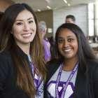 Two women wearing purple in support of PanCAN.