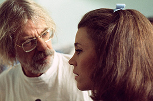 Black and white photo of Hal Ashby with Jane Fonda on the set of Coming Home.