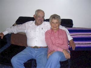 Caucasian couple in their 80s in rodeo gear