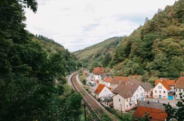 small village in hilly lush terrain near railway