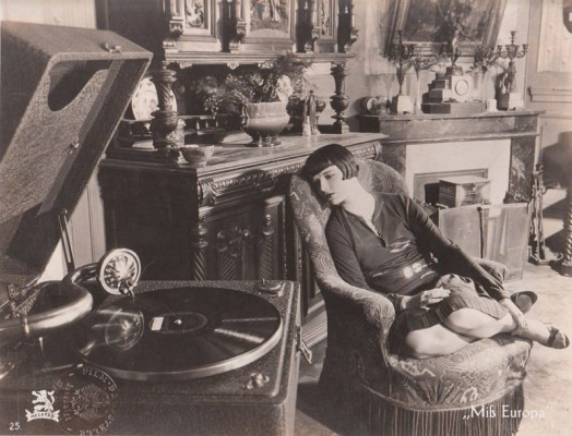 Louise Brooks listens to music.
