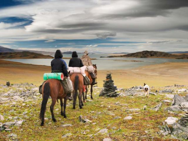 Horse riders in Mongolian wilderness © Pichugin Dmitry | Shutterstock, Inc.