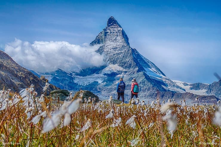 Hiking in the Switzerland alps with Matterhorn peak in the background