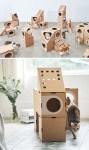 Bygga slott till katten av kartonger