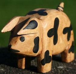 Spotted wooden pig