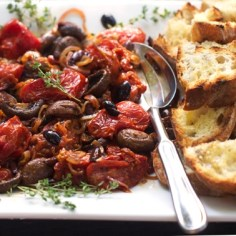 roasted tomato and mushroom bruschetta on a white platter