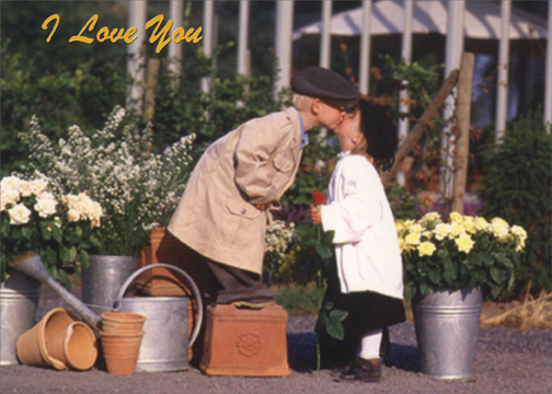 Little Boy And Girl Kiss By Flowers Love Card By Freedom