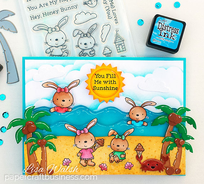 A beach card featuring MFT Beach Bunnies stamp set. It just isn't Summer without a visit to the beach & seeing the beach bunnies having some fun :) Click to visit the blog post for the list of supplies & Copic colours I used, plus the process video to see how it's created. Created by Lisa Walsh @ papercraftbusiness.com #papercraftbusiness #beachcard #myfavoritethings #summercard #cardmaking #mft #stamping #lawnfawn