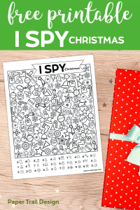 I Spy Christmas game activity and present in the background with text overlay- free printable I spy activity