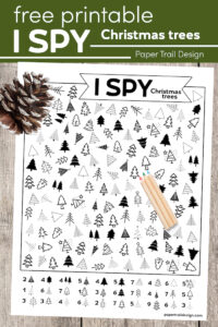 Christmas tree I spy activity page with colored pencils and pinecone with text overlay- free printable Christmas trees
