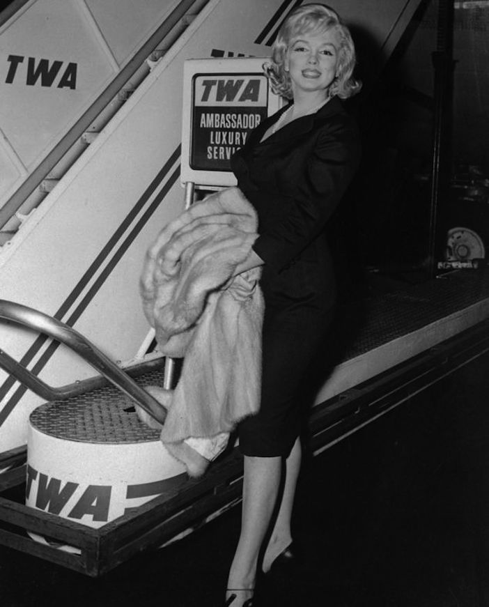 Marylin Monroe boarding her TWA flight in New York City en route to Los Angeles for Spyros Skouras luncheon in honor of the visiting Soviet premier