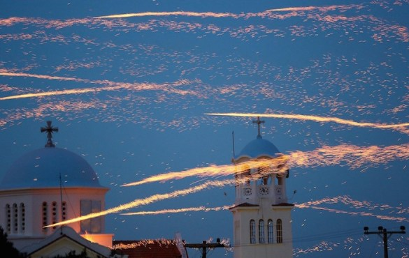 16 Amazing Photos From Annual Easter Rocket Wars in Chios