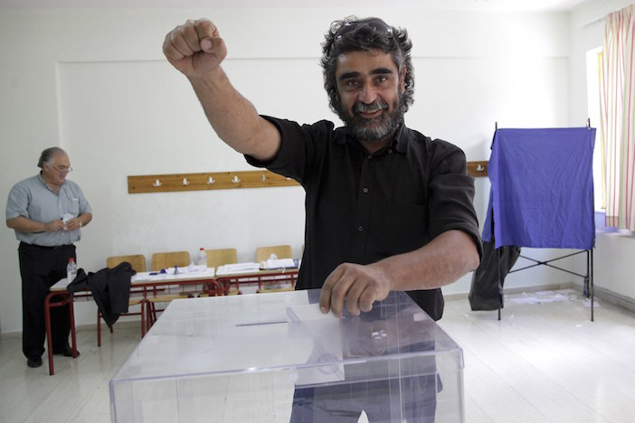A defiant voter in the mountain village of Anogeia