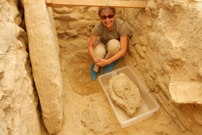 UC's Sharon Stocker with the 3,500 year-old skull found in the warrior's tomb (Photo Department of Classics/University of Cincinnati)