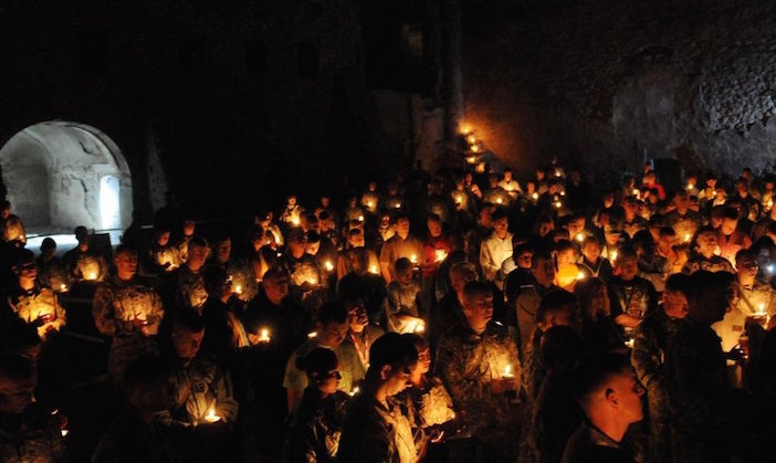 In this April 3, 2010, photo released by the U.S. Army, soldiers celebrate a Catholic Easter Mass at St. Elijah's Monastery on the outskirts of Mosul, Iraq. Satellite photos obtained by The Associated Press confirm the worst fears of church authorities and preservationists: Iraq's oldest Christian monastery has been completely wiped out since the takeover of Mosul by the Islamic State group. (Sgt. Shannon R. Gregory/U.S. Army)