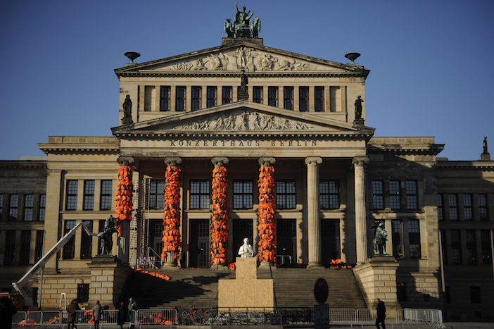 Workers build up an installation by Chinese artist and free-speech advocate Ai Weiwei with life jackets left by migrants on Greek beaches on columns at the Schauspielhaus concert hall during the 66th Berlinale International Film Festival in Berlin, Germany February 13, 2016. Ai Weiwei used about 14,000 discarded life jackets, which he obtained from authorities from the Greek island of Lesbos for this memorial project.