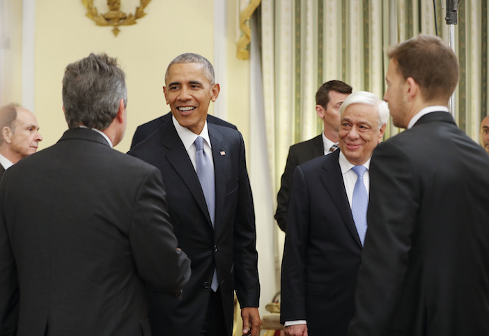 US President Barack Obama and Greek President Prokopis Pavlopoulos, right, greet guests, including Alexi Giannoulias from Chicago (right).