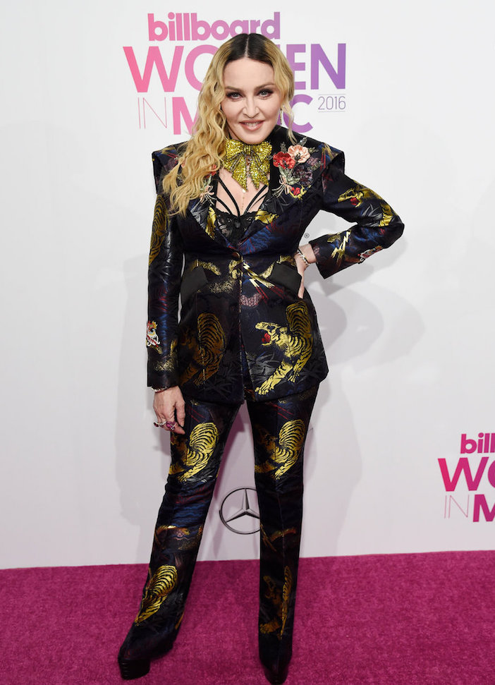 Madonna rocking her Gucci pant suit at the Billboard Women in Music event in New York City where she was named Woman of the Year.