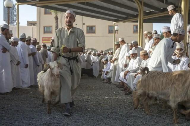 81678838 - nizwa, oman, june 23rd, 2017: omani people at a habta market before eid al fitr