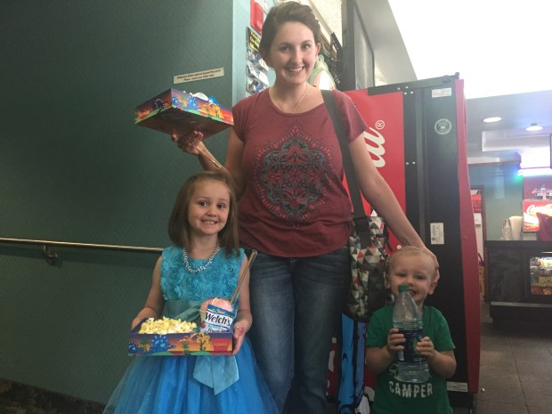 Sarah Wood is with her daughter Elizabeth and her son Tyden at Cinema 7 theater to watch Despicable Me 3 at the free movie event