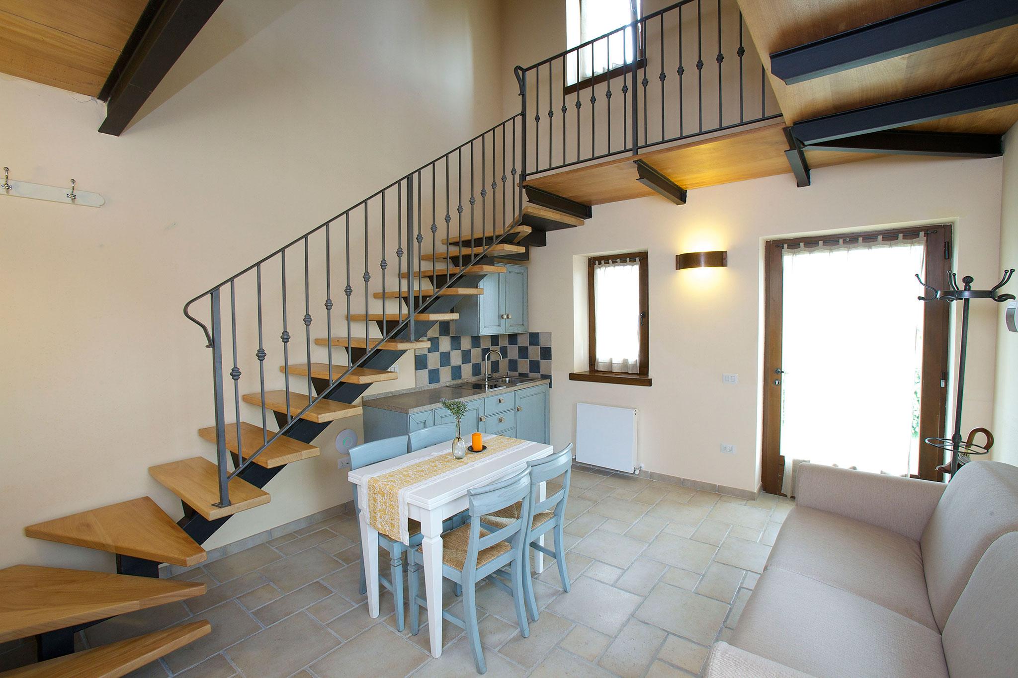 Soggiorno e angolo cottura appartamento Lavanda  Paradiso44