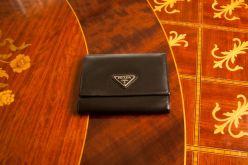 brown-colored prada purse