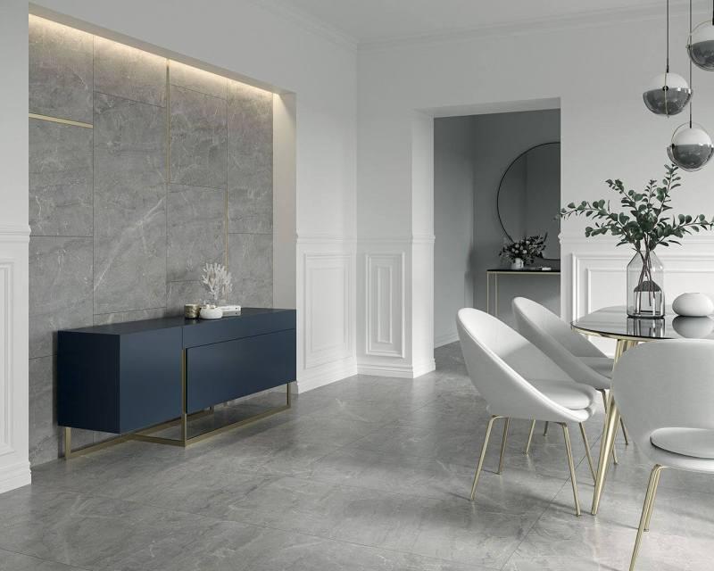 Połączenie szarej podłogi, białych ścian ieleganckich, szklanych dodatków czyni wnętrze zachwycającym wswej klasycznej formie.