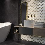 White And Gold Mosaic On A Black Marble Background In A Bathroom Ceramika Paradyz