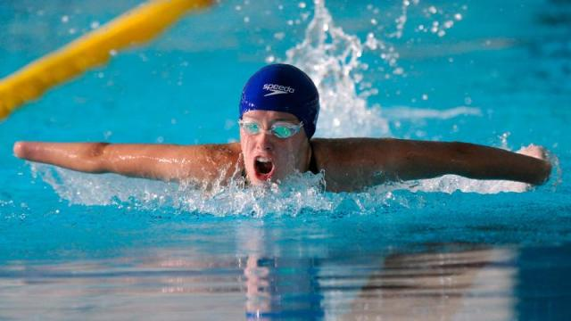 Amy Marren swimming in a butterfly event