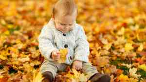 10 Things Your Toddler Can Learn From Playing in the Leaves