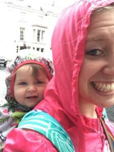 katie and her toddler wearing a woven wrap over their coats